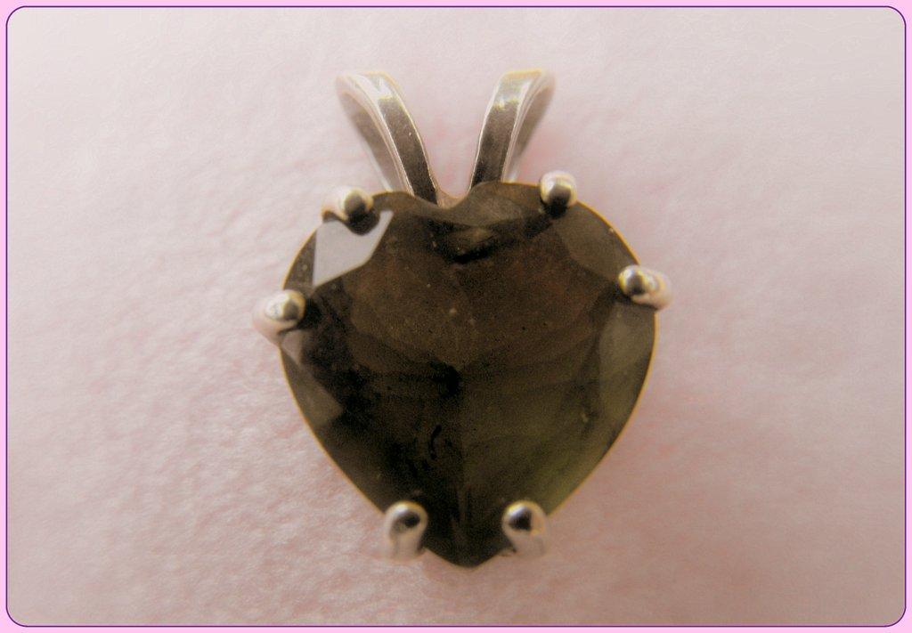 a moldavite heart pendant