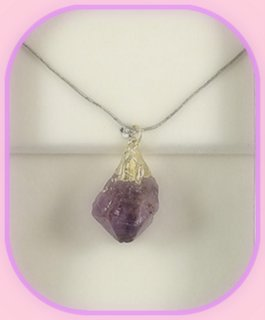 Rough Amethyst Point Pendant approximately 3 x 2 cm; Length of the chain is 60 cm.