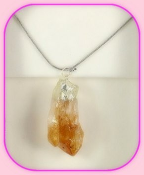 Rough Citrine Point Pendant approximately 3 x 2 cm; Length of the chain is 60 cm.