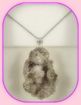 Rough Half Geode Mineral Pendant approximately 3 x 2 cm; Length of the chain is 60 cm
