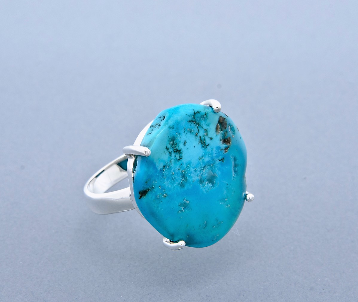 Turquoise claw set ring